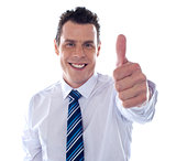 Corporate man showing thumbs up