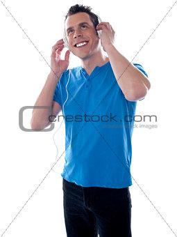 Attractive caucasian male listening music