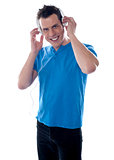 Attractive guy holding headphones