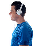 Side pose of a man with headphones