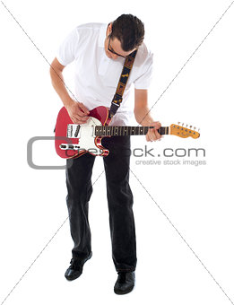 Casual man with guitar looking down