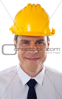 An architect wearing yellow safety helmet