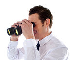 Male executive looking through binoculars