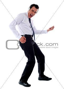 Business representative enjoying music