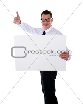 Thumbs up businessman holding banner ad
