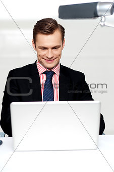 Business male watching videos on laptop