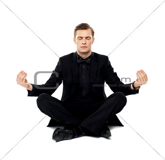 Smart young man in party wear doing yoga