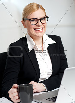 Beautiful businesswoman holding coffee cup