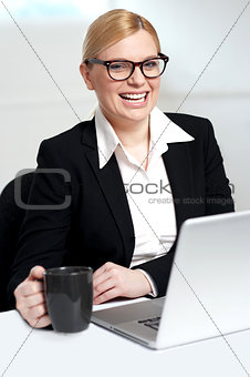Attractive female holding black coffee cup