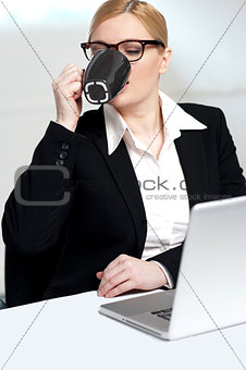 Corporate lady drinking coffee