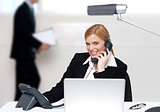 Attractive secretary attending phone call