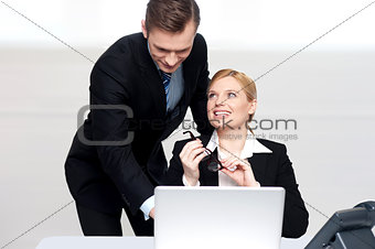 Business people at work. Male pointing at laptop