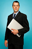Businessperson carrying a laptop