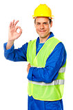 Handsome young worker gesturing okay sign