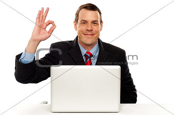 Attractive businessperson showing okay gesture
