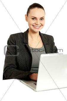Business professional operating laptop