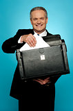 Businessman keeping documents safely