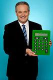 Senior manager showing big green calculator