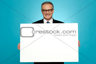 Business representative holding blank ad board