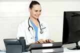 Medical professional working on computer