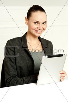 Corporate lady using wireless tablet device