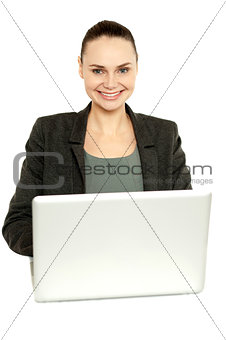 Attractive corporate female working on laptop