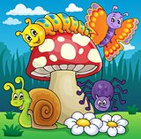 Toadstool with animals on meadow