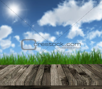 3D wooden table against blue sky