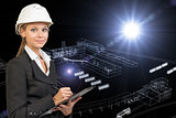 Business woman holding clipboard. Wire-frame render of industrial zone on background