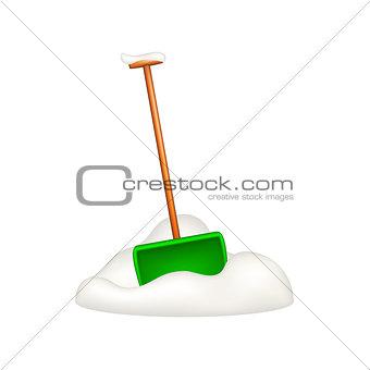 Green snow shovel standing in snow