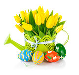 Easter eggs with spring flowers in watering can