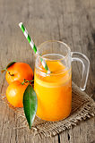 Clementines and a glass of juice