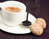 cup of italian espresso coffee and biscuits
