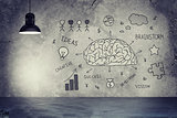 Lamp and concrete wall with sketches of brain, diagram, bulb, money, ideas, star
