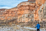 hiker in sandstone canyon
