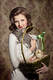 woman with rabbit and easter eggs