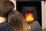 Couple at home resting near fire place