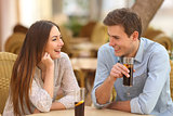 Couple or friends talking in a restaurant