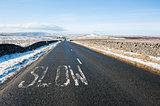 Country road through winter rural scene