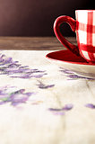 Detail of coffee cup laid on wooden vintage table