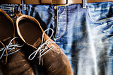 Vintage style shoes on denim jeans