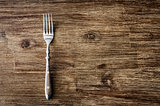 Dining fork on vintage wooden table