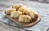 Sausage rolls on the wooden board