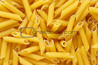 Backgrund of italian penne rigate pasta