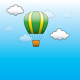 Vector Bright Hot Air Balloon flying in the blue sky
