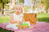 Cute Baby Girl Enjoying Her Easter Eggs on Picnic Blanket