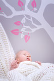 Cute baby in bedroom