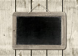 Blackboard on a white wood wall background