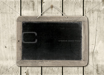 Blackboard on a white wood wall background