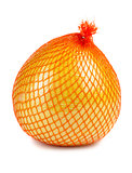 The pomelo fruit wrapped in plastic reticle